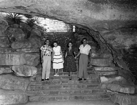 Foursome photo op at the entrance to the cavern at